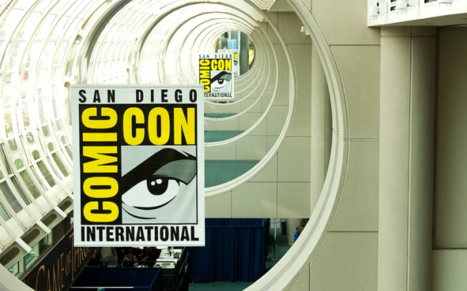 Banners for the 2012 San Diego Comic Con align in the convention center rafters.