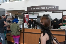 Cosplayers wait through long lines to order Starbucks coffee.