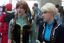 Anna and Elsa from 'Frozen' chat with an attendee.