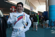 Captain Eo flashes his uniform in the convention center.