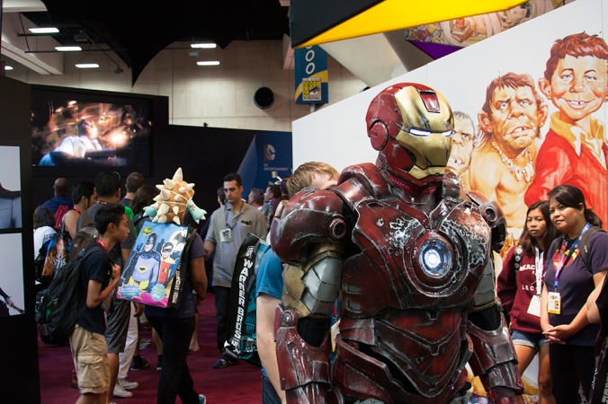 An 'Iron Man' cosplayer makes his way through the audience near the DC Comics booth.