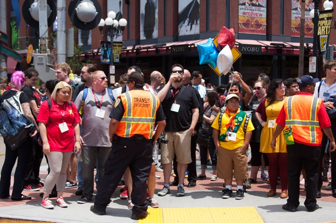 Russel from 'Up' awaits a crossing guard's signal at San Diego Comic Con.