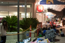 Camps are made in an overnight line for the exhibit hall's next day.