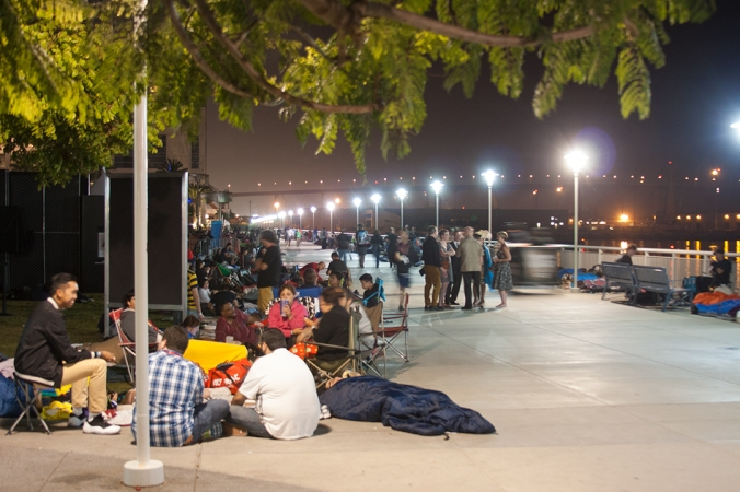 Fans camp out overnight along the San Diego harbor for a chance to enter Saturday's panels.