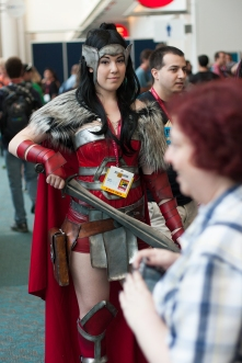 A costumed warrior catches a glance in the middle of a crowded floor.
