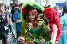 Two versions of Poison Ivy strike a pose.