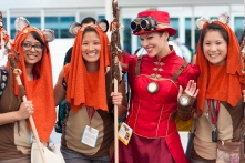 Ewoks share a photo with a Steampunk cosplayer.
