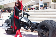 Batwoman poses next to the Batpod for the DC Comics photoshoot on Saturday.