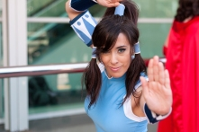 Korra shows off her bending in front of the convention center.