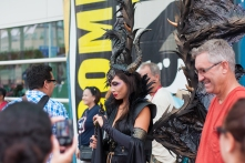 Maleficent unfolds her wings for fans.