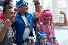 A family of 'Lazy Town' fans flex for the crowd.