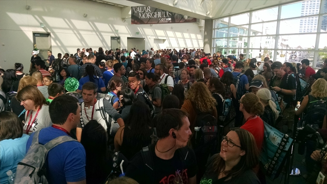 Thousands await the opening of the exhibit hall and ballrooms for San Diego Comic Con 2014.