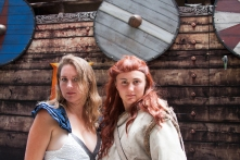 Two cosplayers for 'Game of Thrones' wait for a trip aboard a longboat.