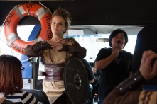 A shieldmaiden goes over the safety procedures aboard the 'Vikings' longboat.