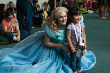 A young fan snaps a picture with Cinderella.