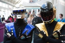 Daft Punk cosplay as Sub-Zero and Scorpion.